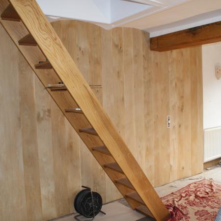 Habillage d'un mur avec parquet chêne massif légend non traité